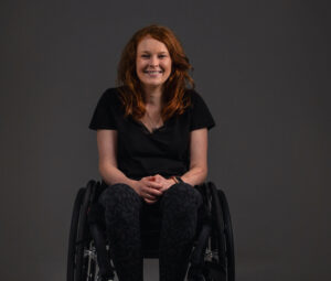 Chloe Kennedy in a wheelchair smiling