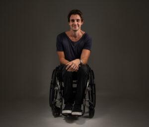 Dean Martelozzo in wheelchair smiling