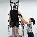 Physiotherapist with trial participant