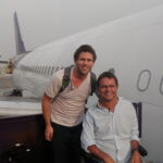 Philip and a carer next to a plane