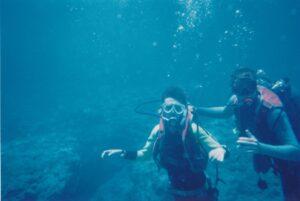 Philip scuba diving with a friend