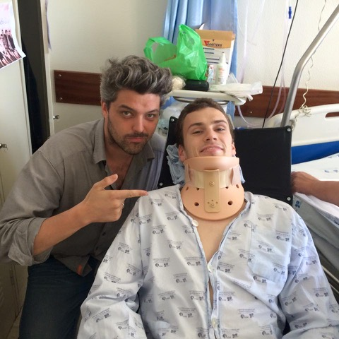 Tom in hospital with a neck brace