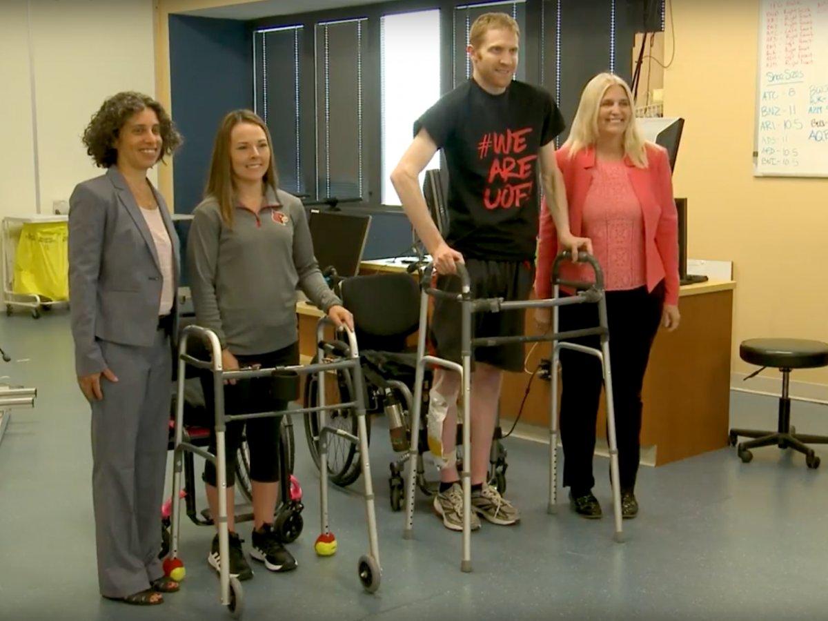 A paraplegic and quadriplegic regain the ability to walk