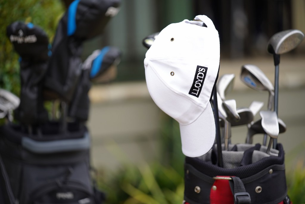 Lloyds hat on golf clubs
