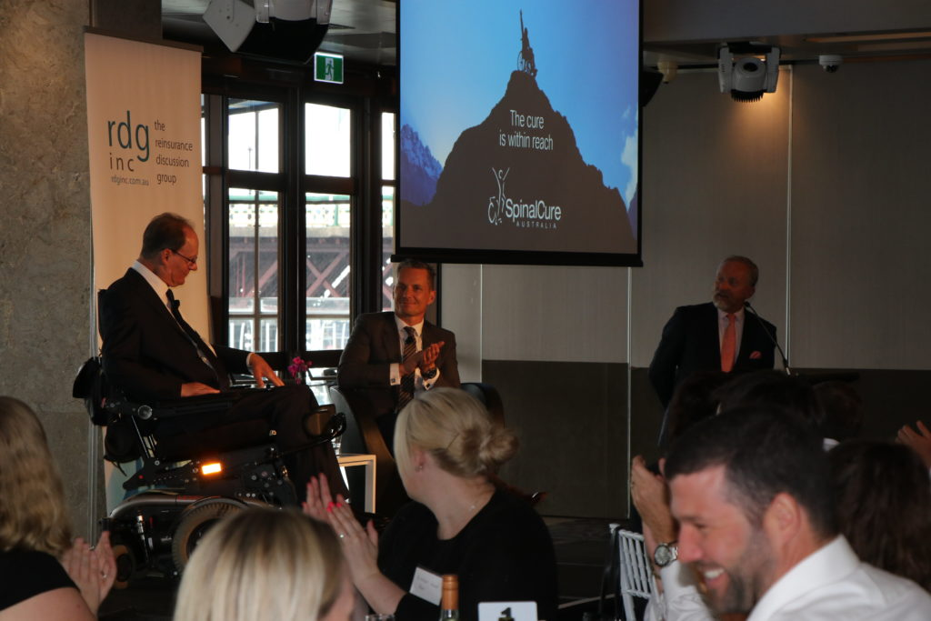 Duncan Wallace, CEO SpinalCure, and Mark Senkevics, Managing Director of Swiss Re ANZ on stage at the RDG event. (Photo by: SpinalCure Australia)